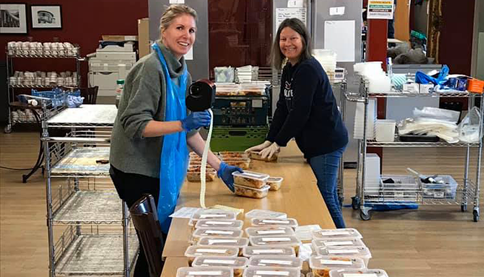 Some of our wonderful A-Team processing the meals for storage